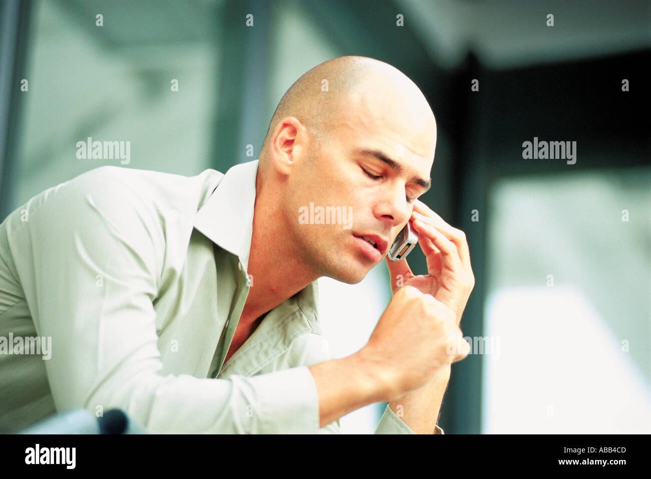 Man on cellphone - Stock Image