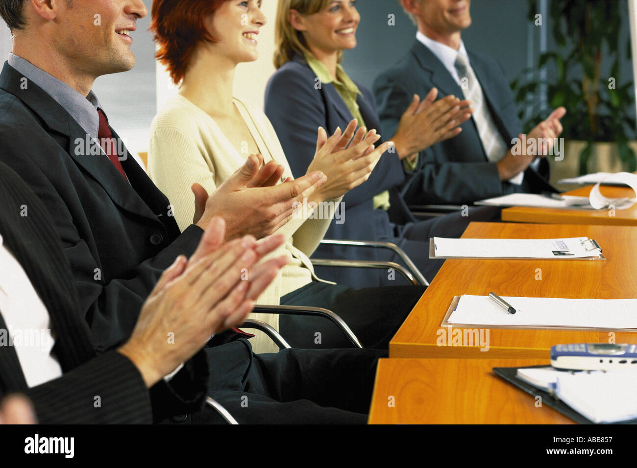 Businesspeople clapping hands - Stock Image