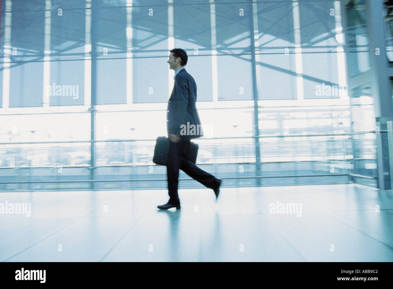 Businessman in airport terminal Stock Photo