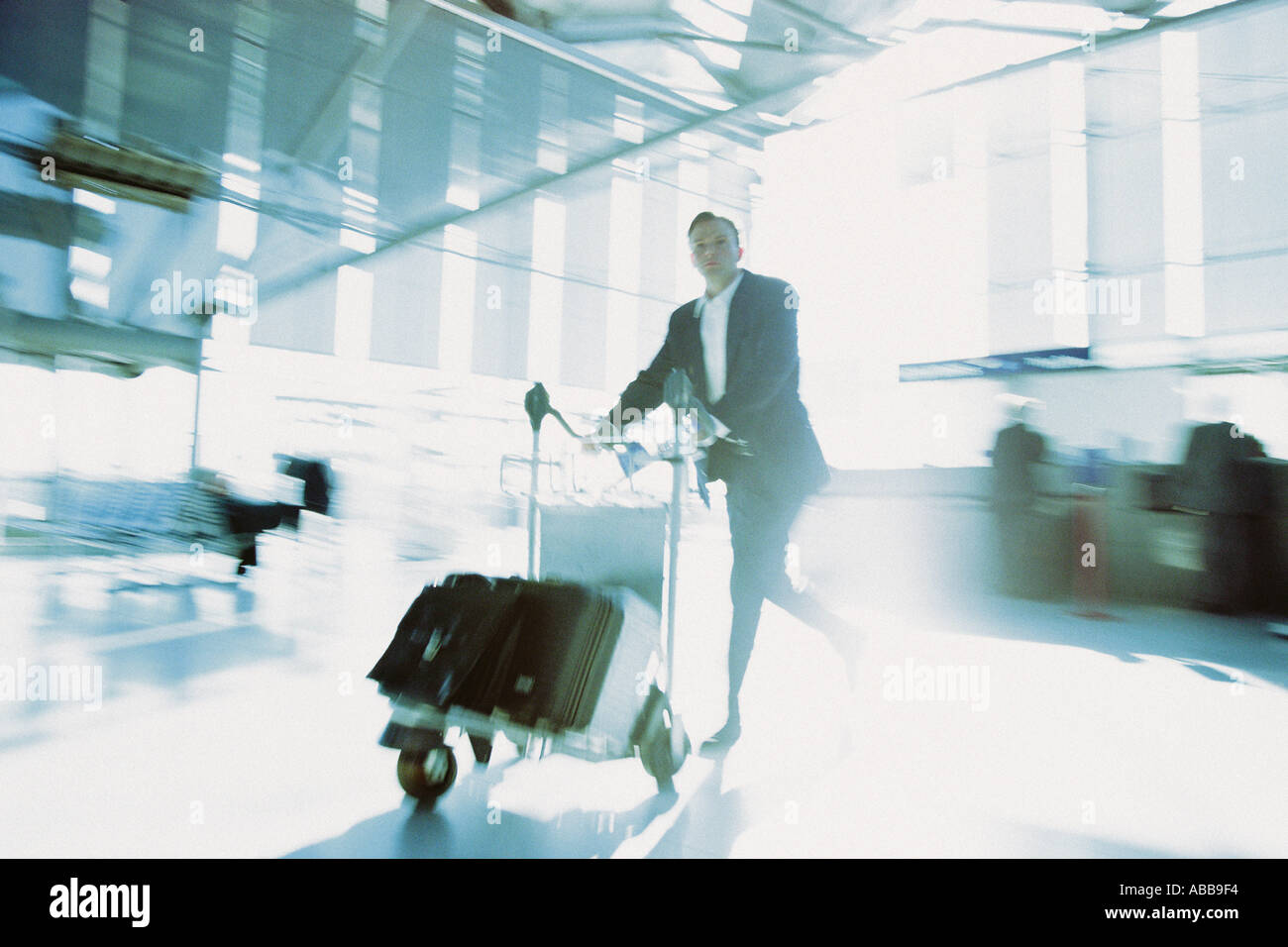 Businessman rushing in airport terminal Stock Photo