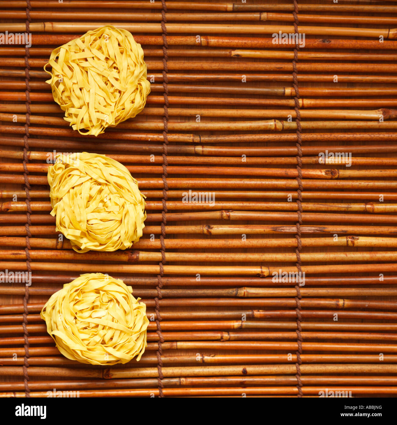 Noodles on Bamboo Placemats Stock Photo