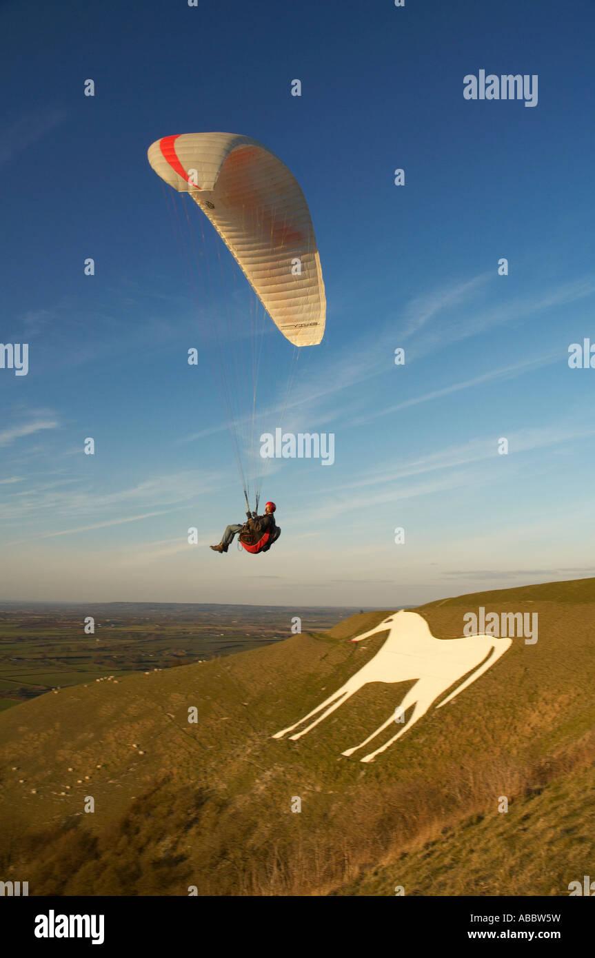 Paragliding over Westbury White Horse, Wiltshire, England Stock Photo