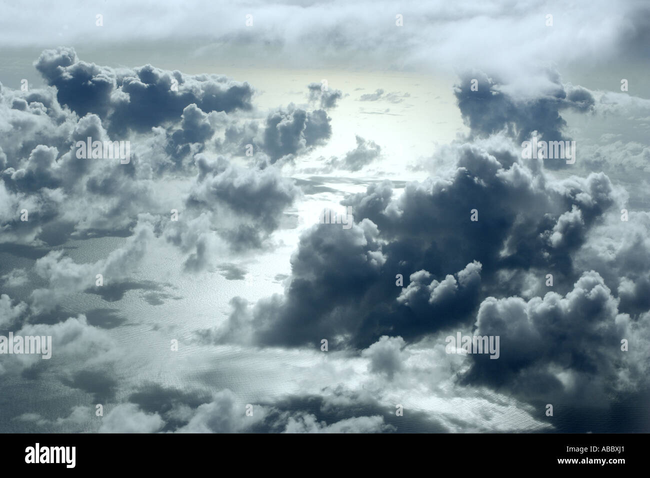 In the Clouds over the Coral Sea from Lizard island to Cairns, Queensland, Australia - Stock Image