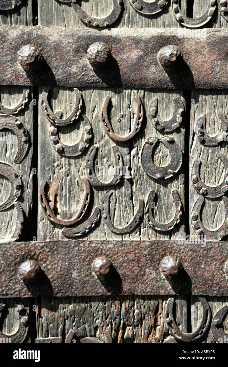 Nailed old horseshoes on a wooden door Akbar Mosque Fatehpur Sikri Uttar Pradesh India - Stock Image