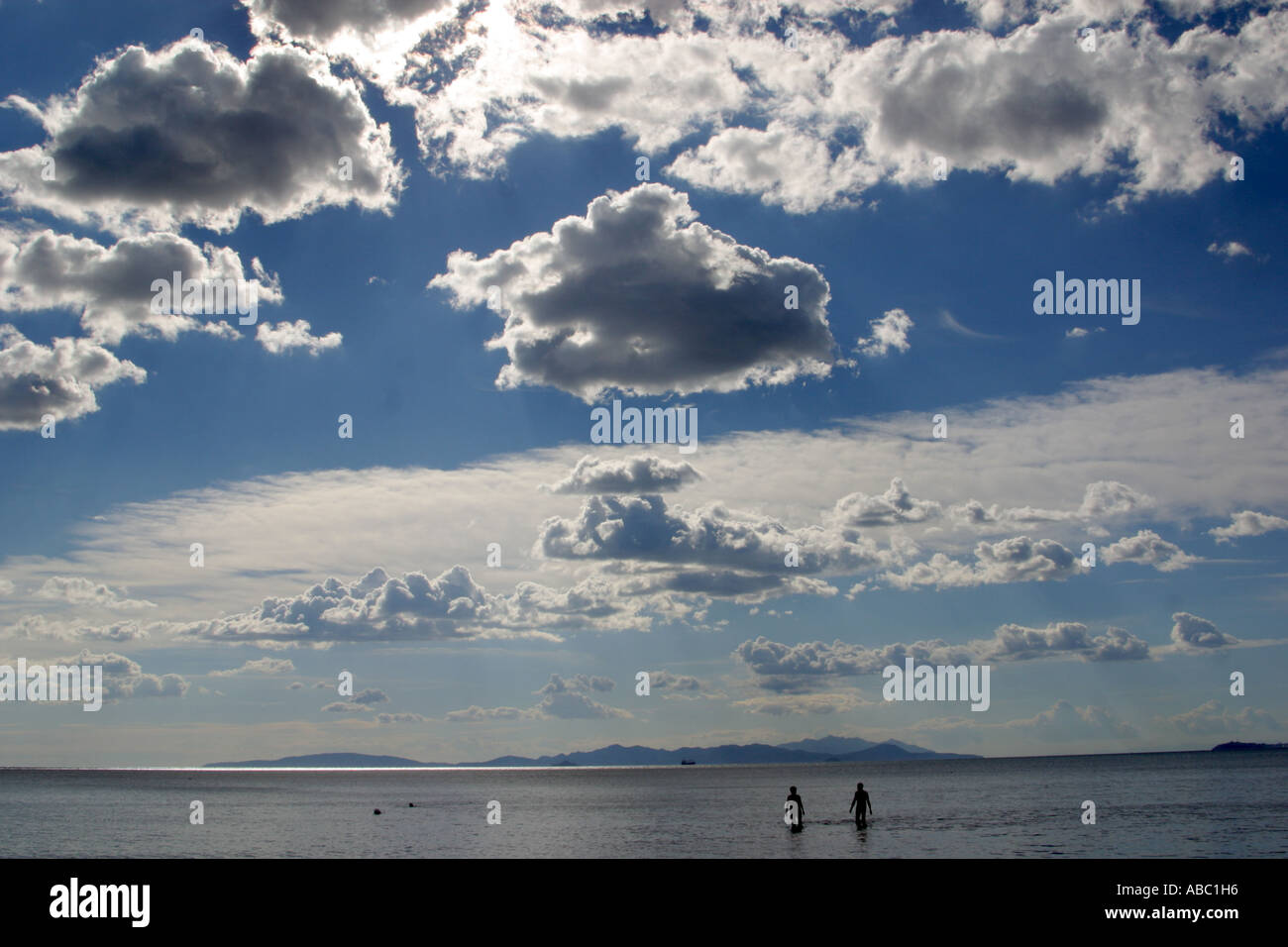 Clouds above the beach of Follonica view to Elba Tuscany Italy - Stock Image