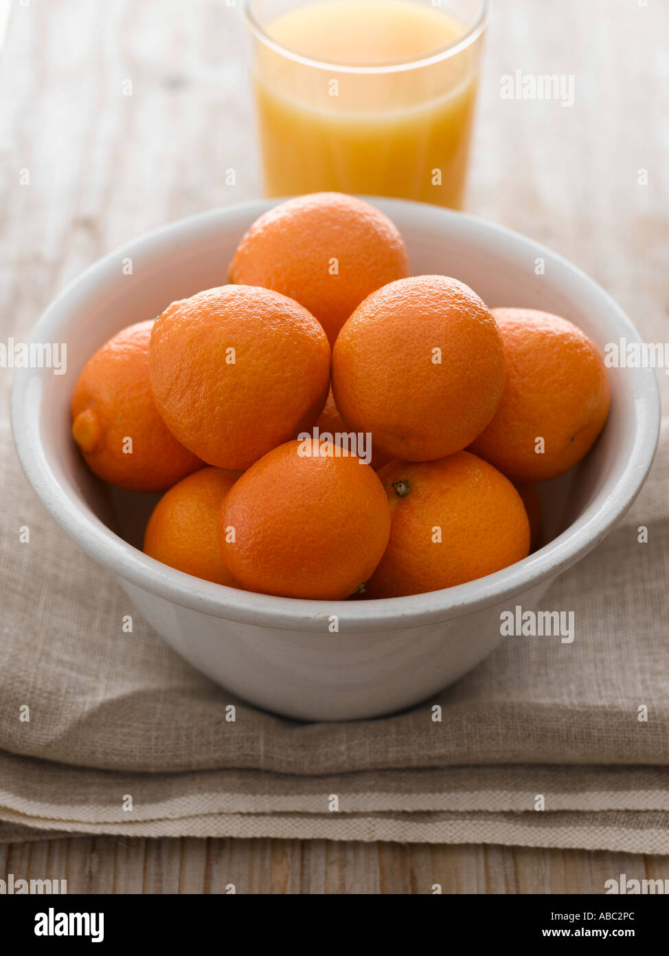 Bowl of oranges and juice - high end Hasselblad 61mb digital image - Stock Image