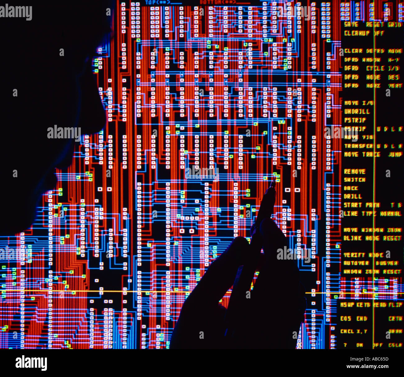 High Tech - Circuit board design computer screen, silhouette of design engineer / Silicon Valley, California, USA. - Stock Image
