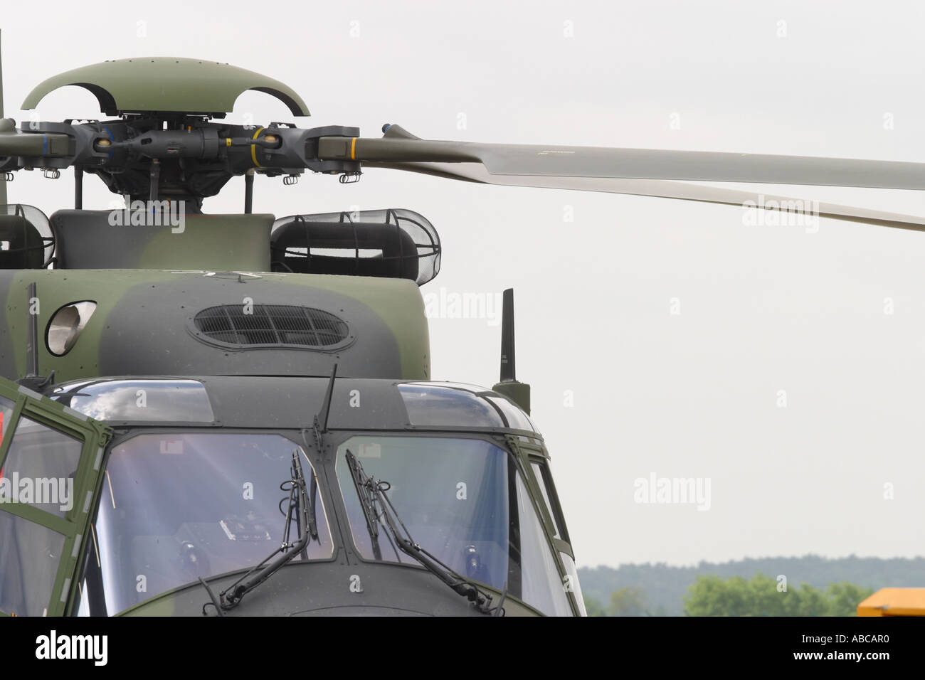 Military helicopter cockpit and rotor blades of the NHI NH-90 joint European aviation aerospace cooperation venture - Stock Image