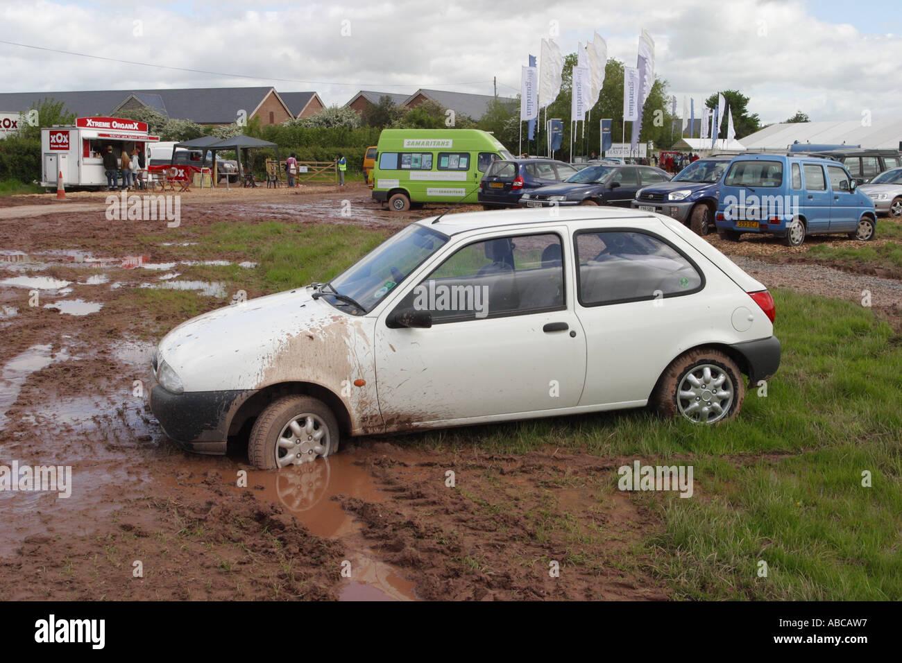 Car stuck in mud muddy car park at Hay Festival May 2006 Stock Photo