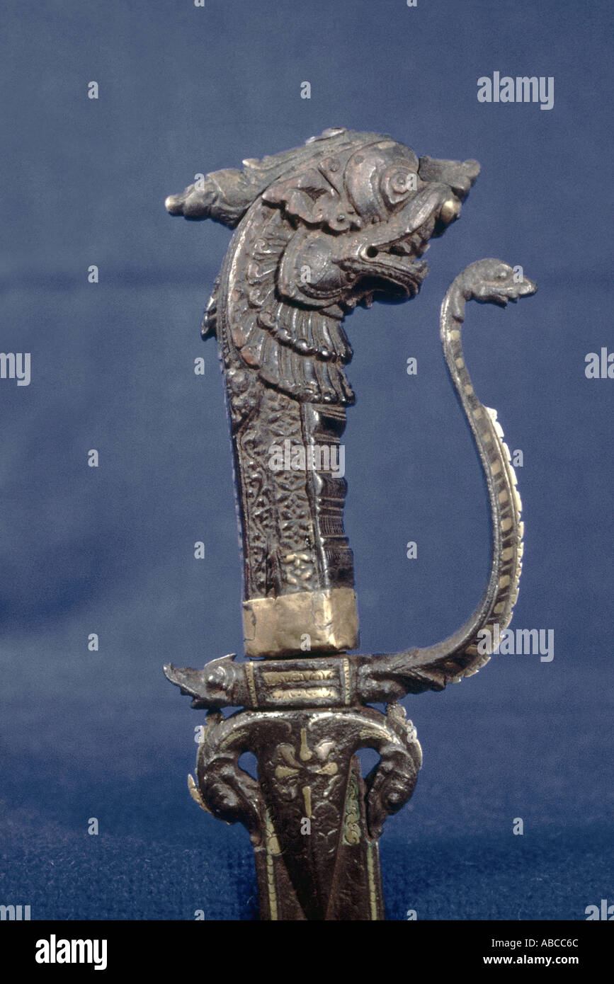 Sword hilt Makara head in bone The blade is made of iron inlaid with brass and silver - Stock Image