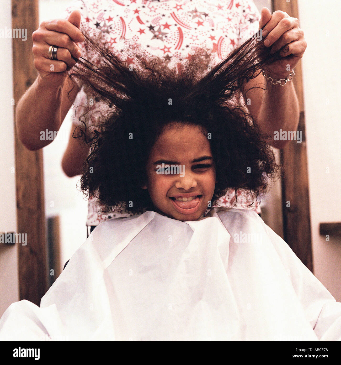 Girl at hairdressers - Stock Image