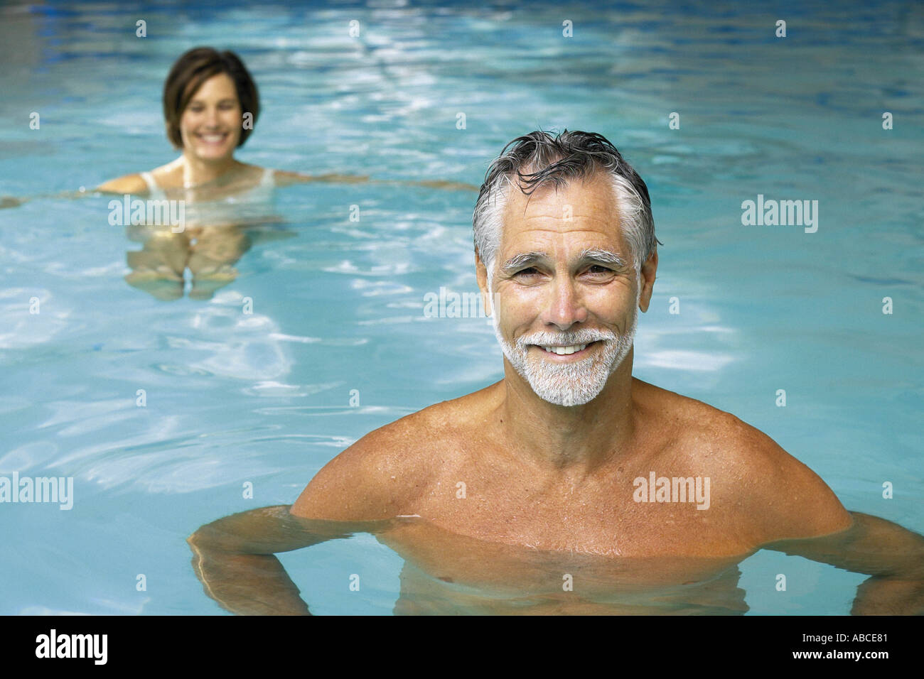 Man and woman in swimming pool - Stock Image
