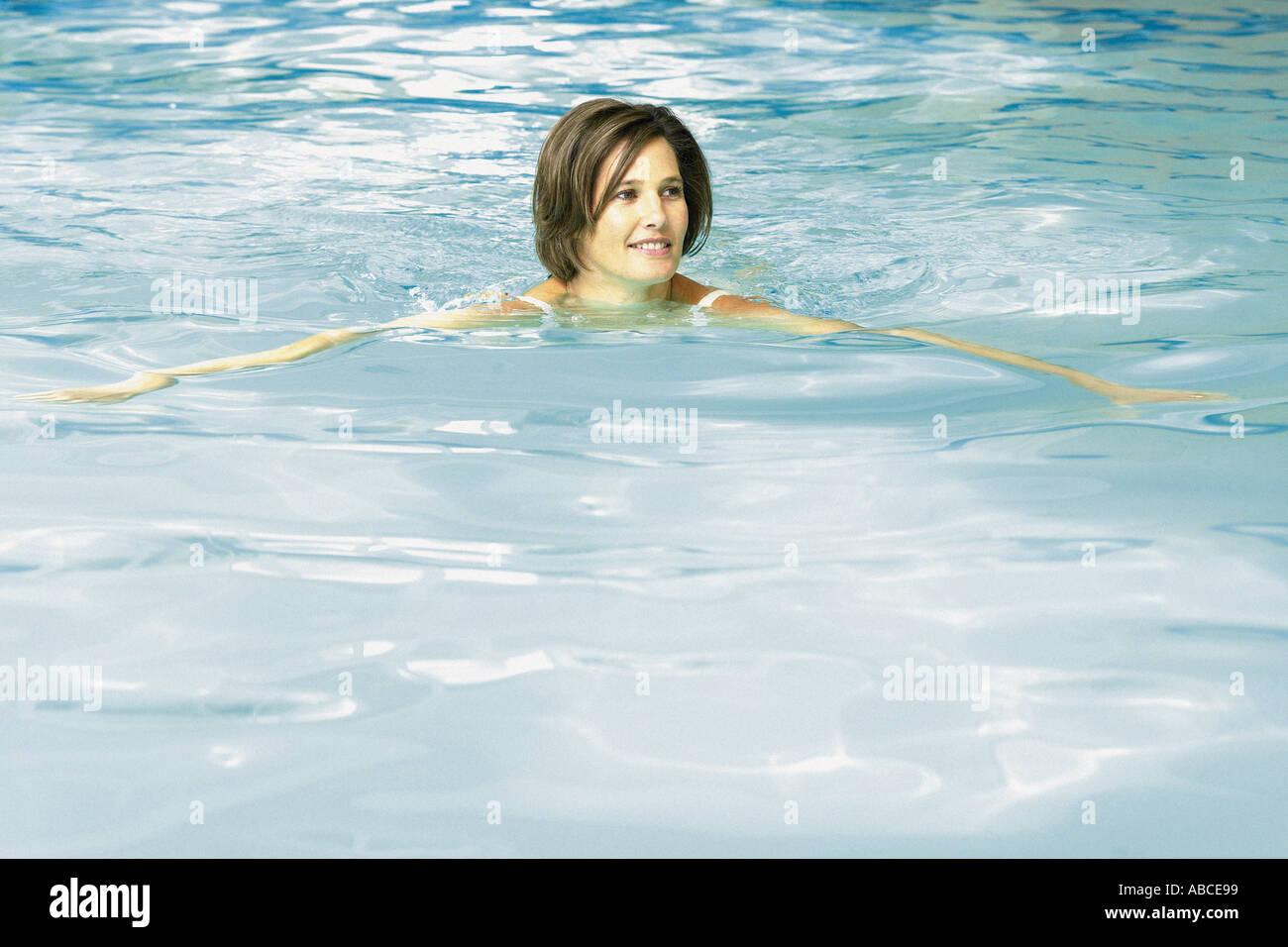 Woman in swimming pool - Stock Image