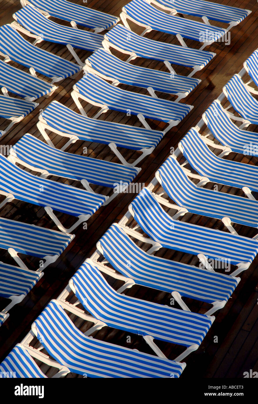 Astonishing Lounge Deck Pool Chairs Empty Blue White Stripes Stock Photo Cjindustries Chair Design For Home Cjindustriesco
