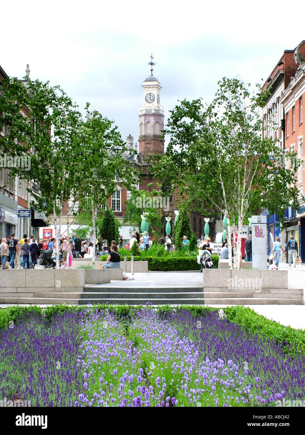 Warrington town centre and Holy Trinity Church clock tower form Buttermarket Street Warrington England Stock Photo