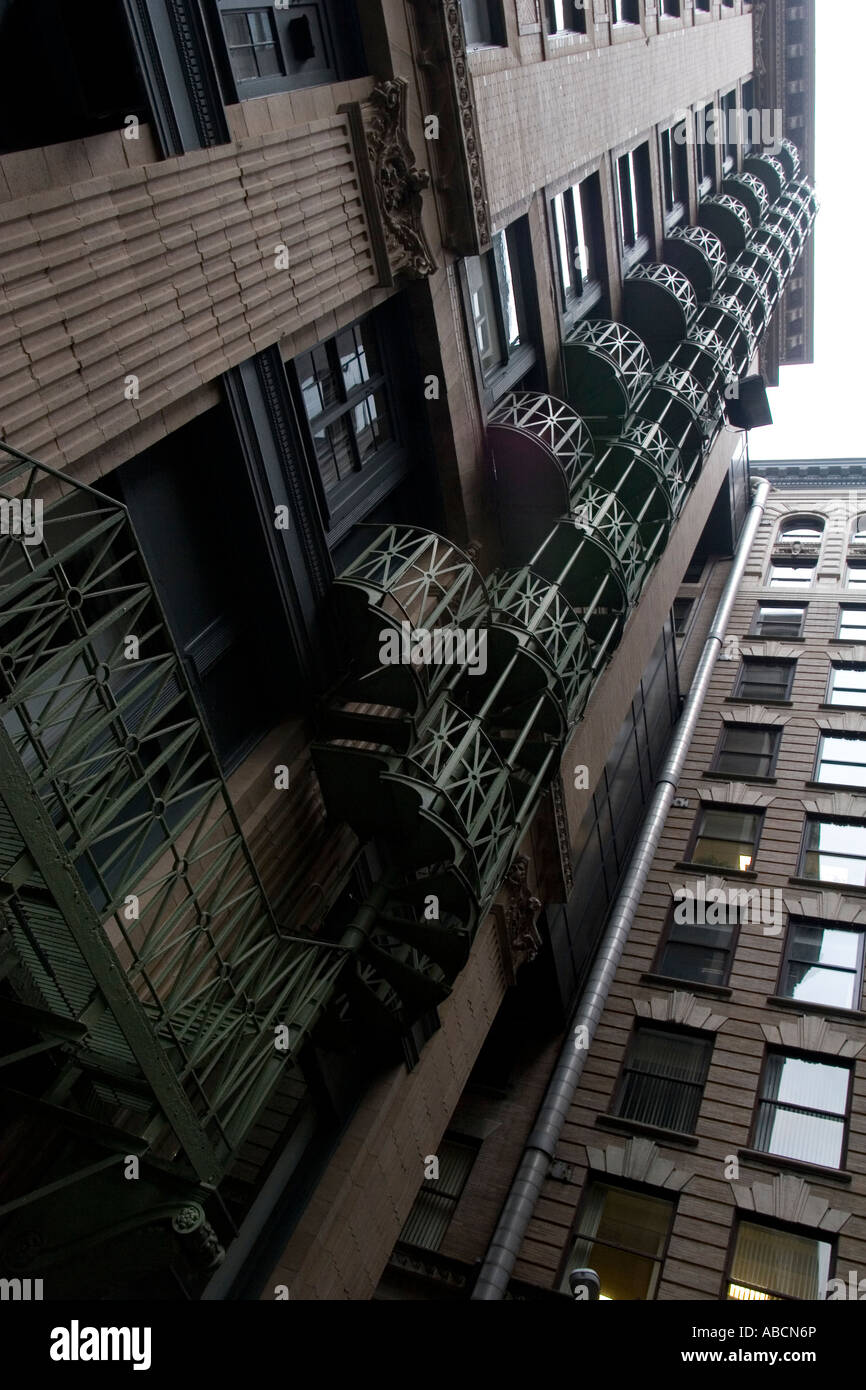 An old fire escape attached to an apartment building in Boston, Massachusetts. - Stock Image