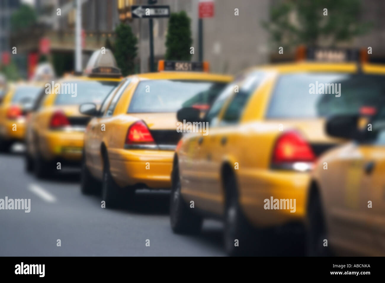 Queue of yellow taxi cabs - Stock Image