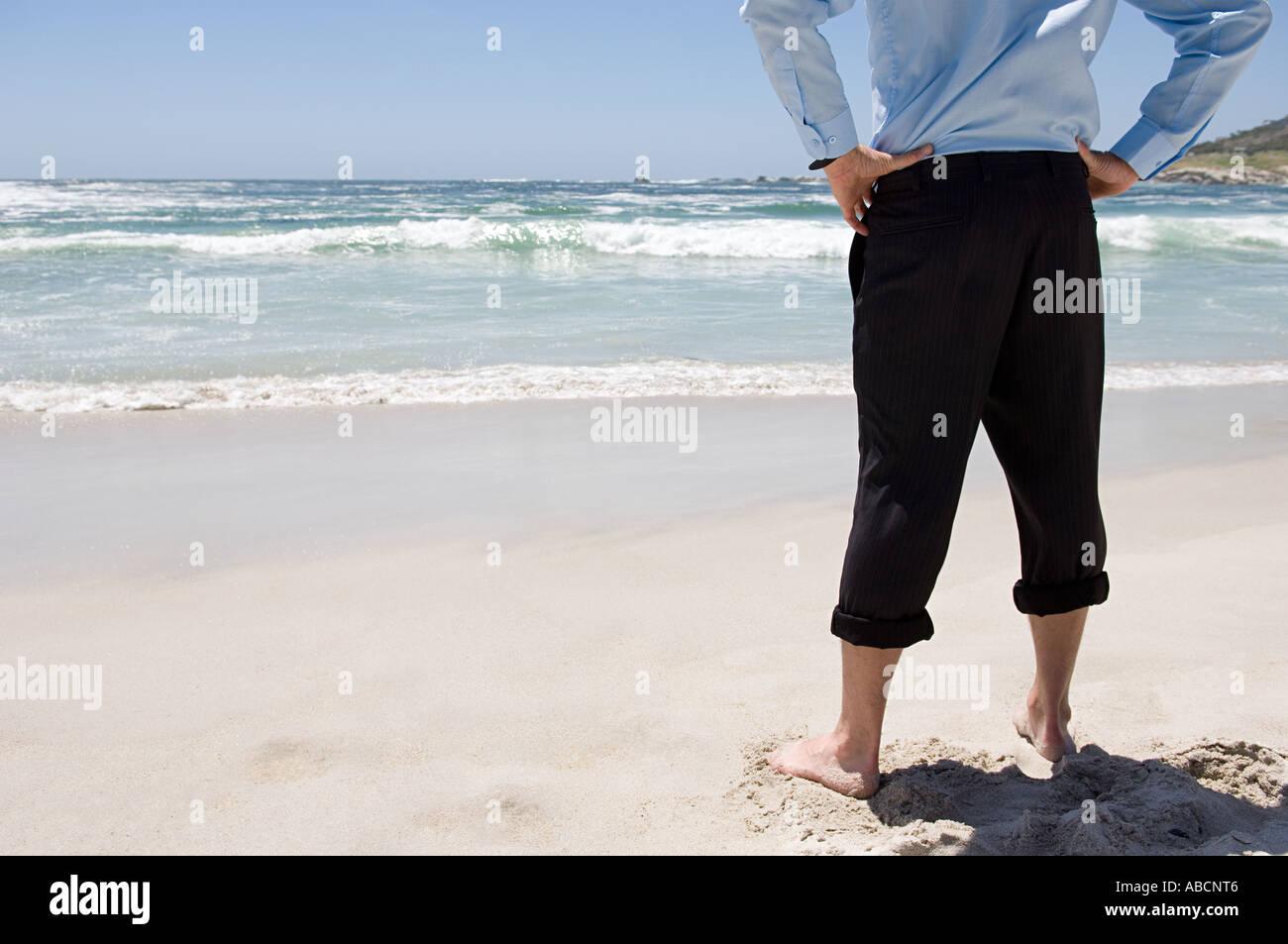 Businessman at the beach Stock Photo