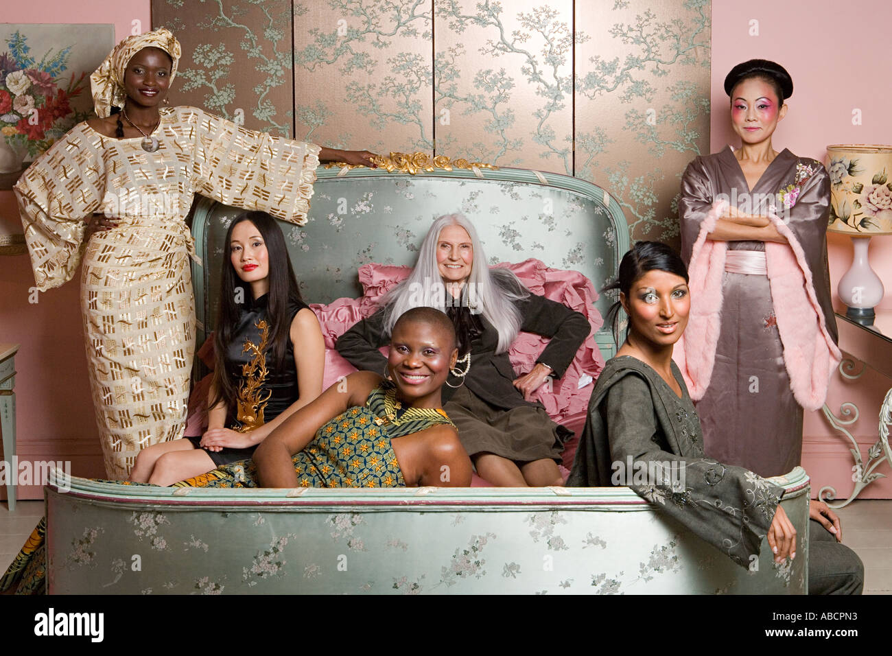 Six women wearing traditional clothing - Stock Image