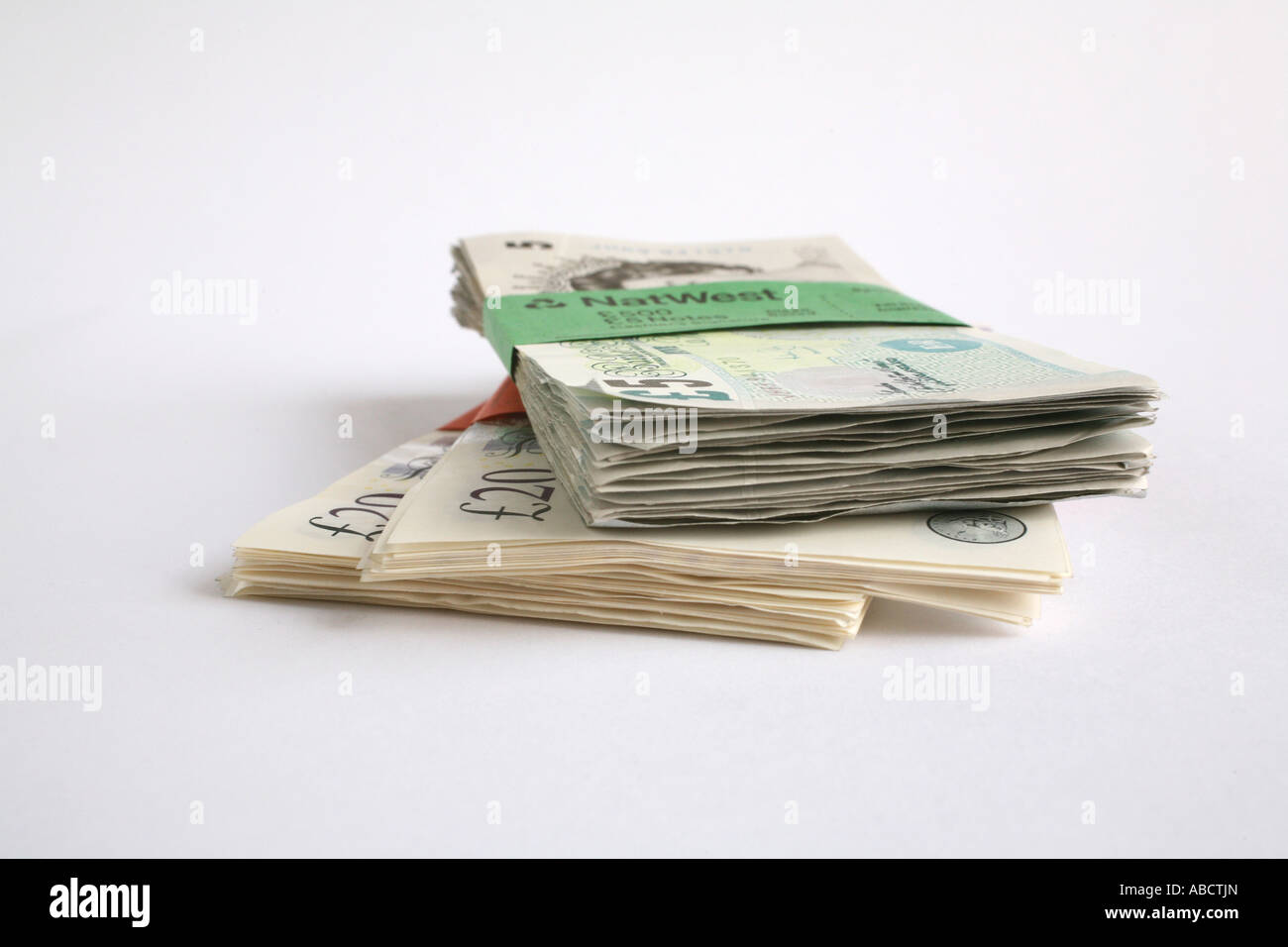 Bundles of twenty and five pound notes - Stock Image