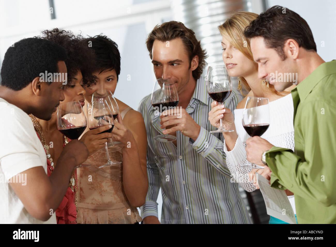 Friends appreciating wine - Stock Image