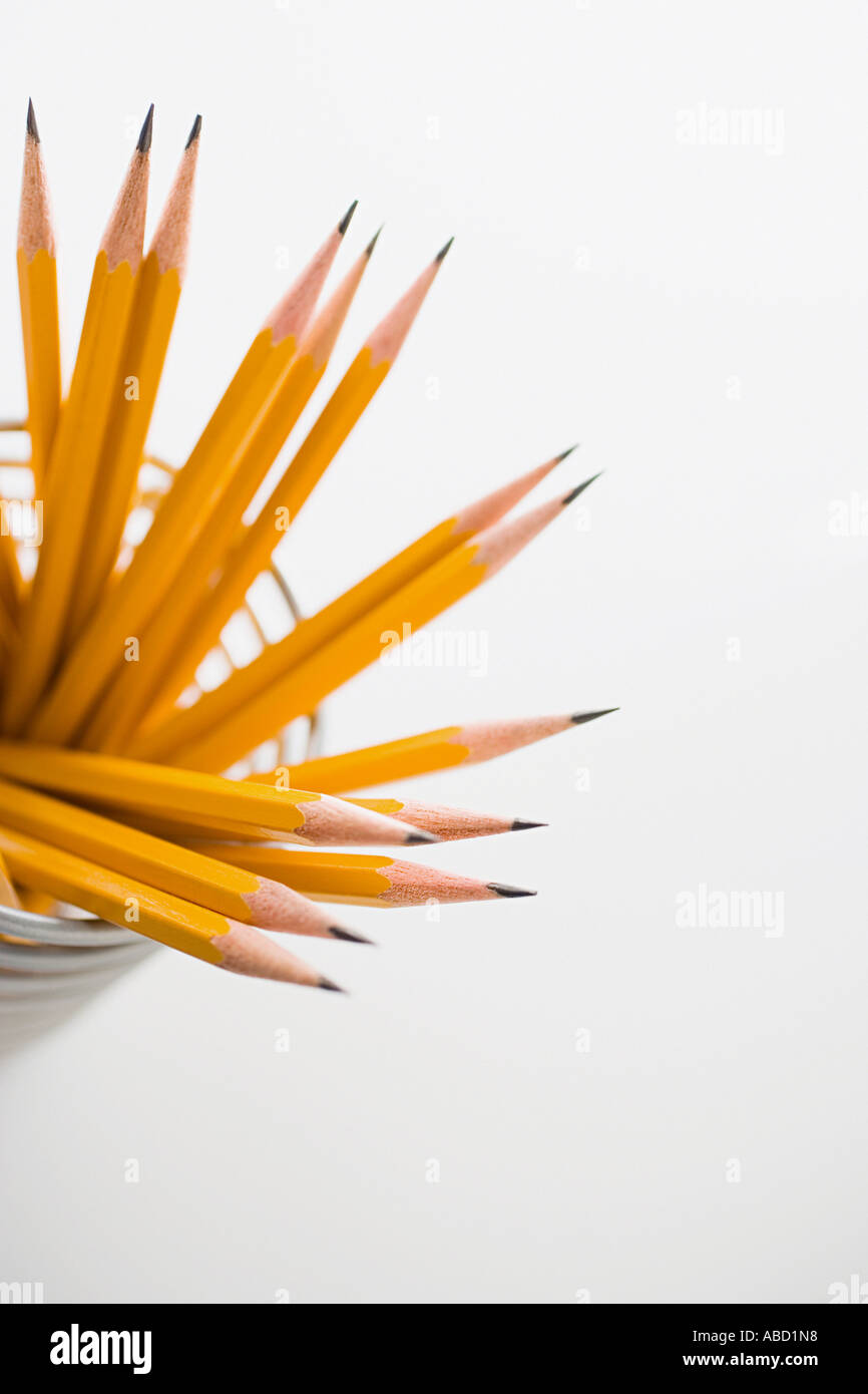 Pencils in a desk tidy - Stock Image