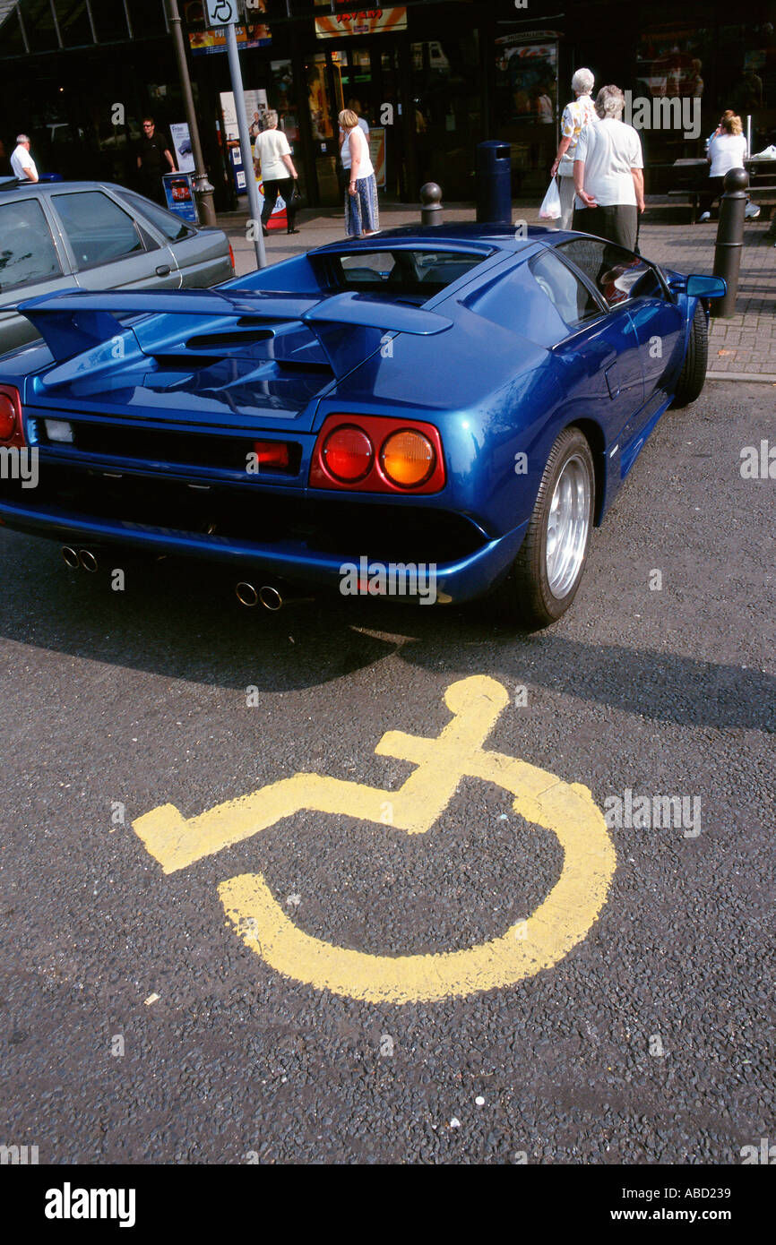 Sports car parked in disabled bay - Stock Image
