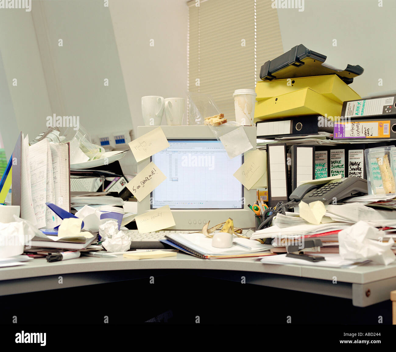 Messy office desk - Stock Image