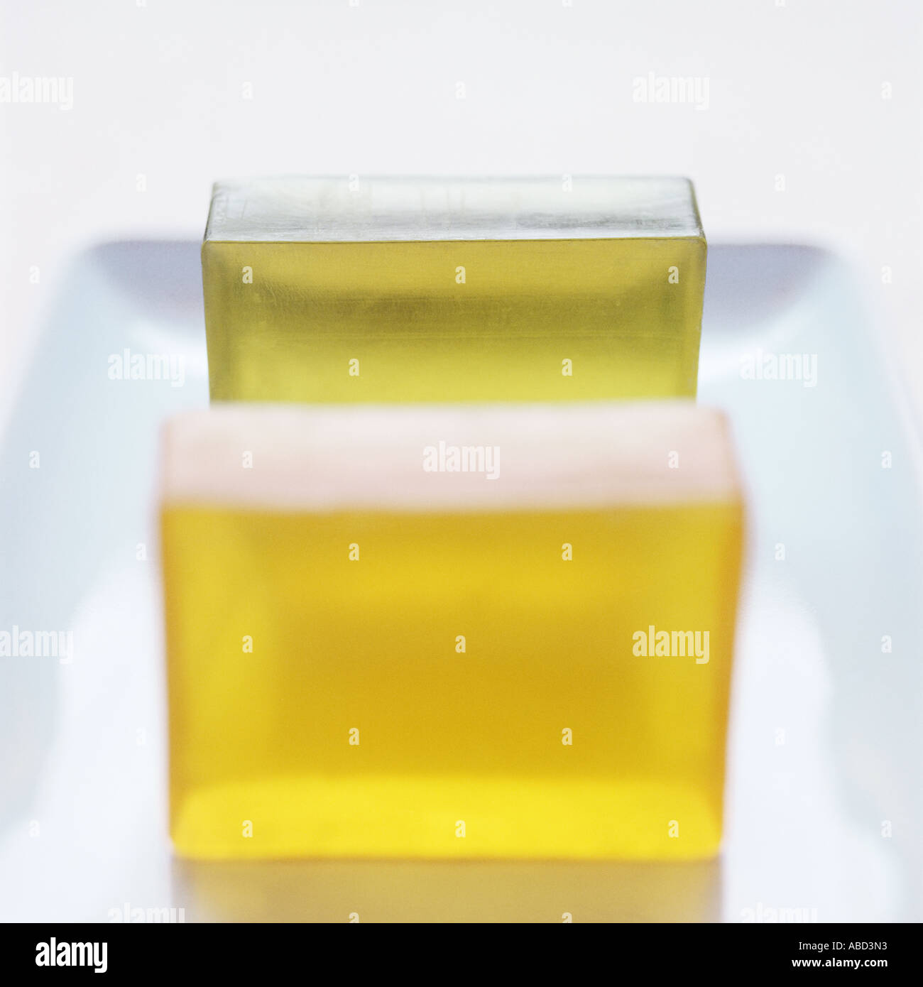 Unused bars of soap in a dish - Stock Image