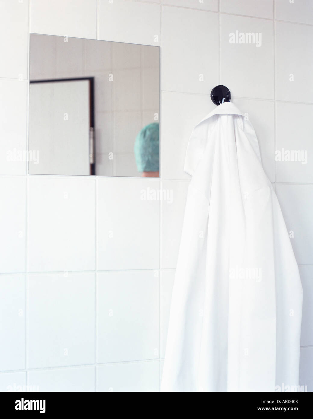 Surgical gown hanging on wall - Stock Image