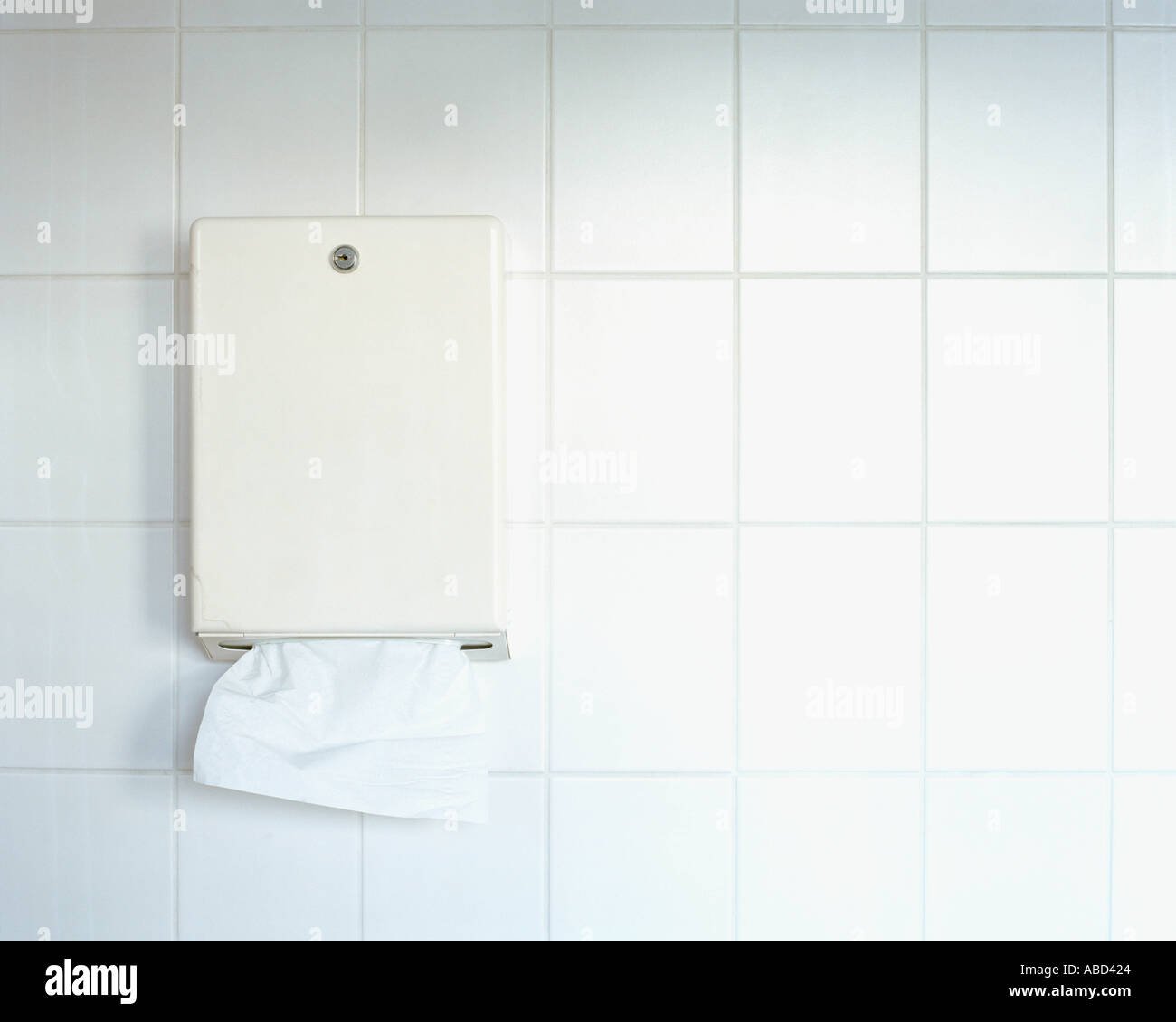 Paper towel dispenser on wall - Stock Image