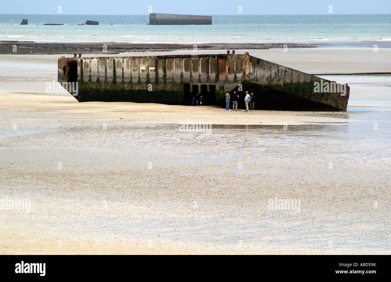 Arromanches Normandy France Remains of Mulberry Harbour on Gold Beach - Stock Image