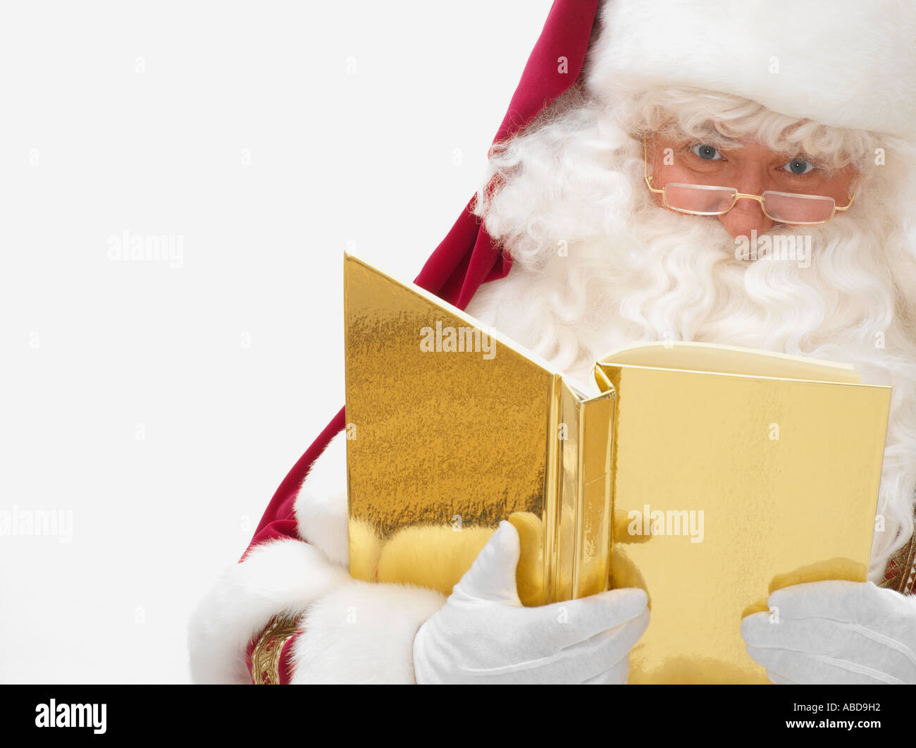 Santa claus with a book - Stock Image