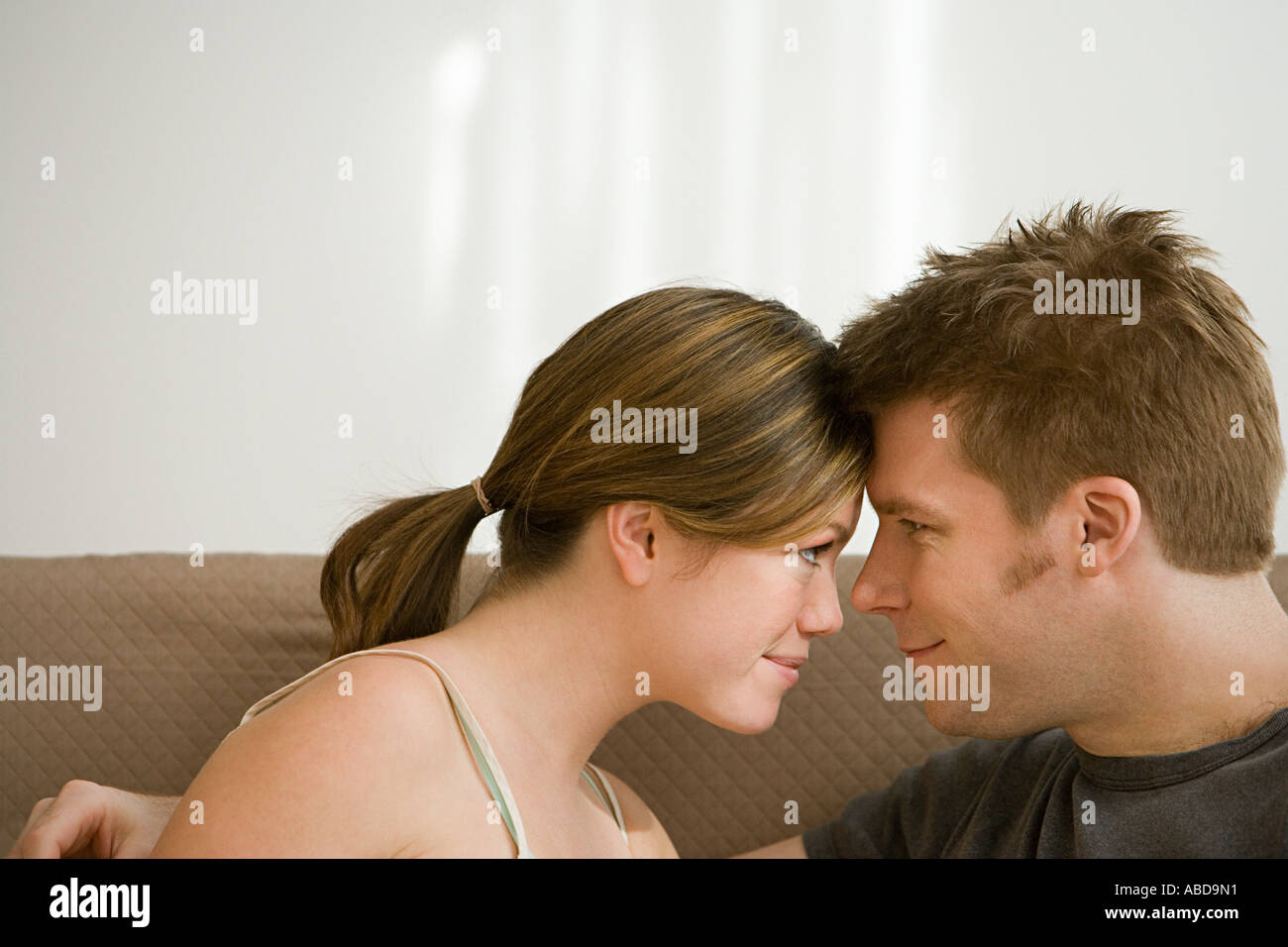 Couple touching foreheads - Stock Image