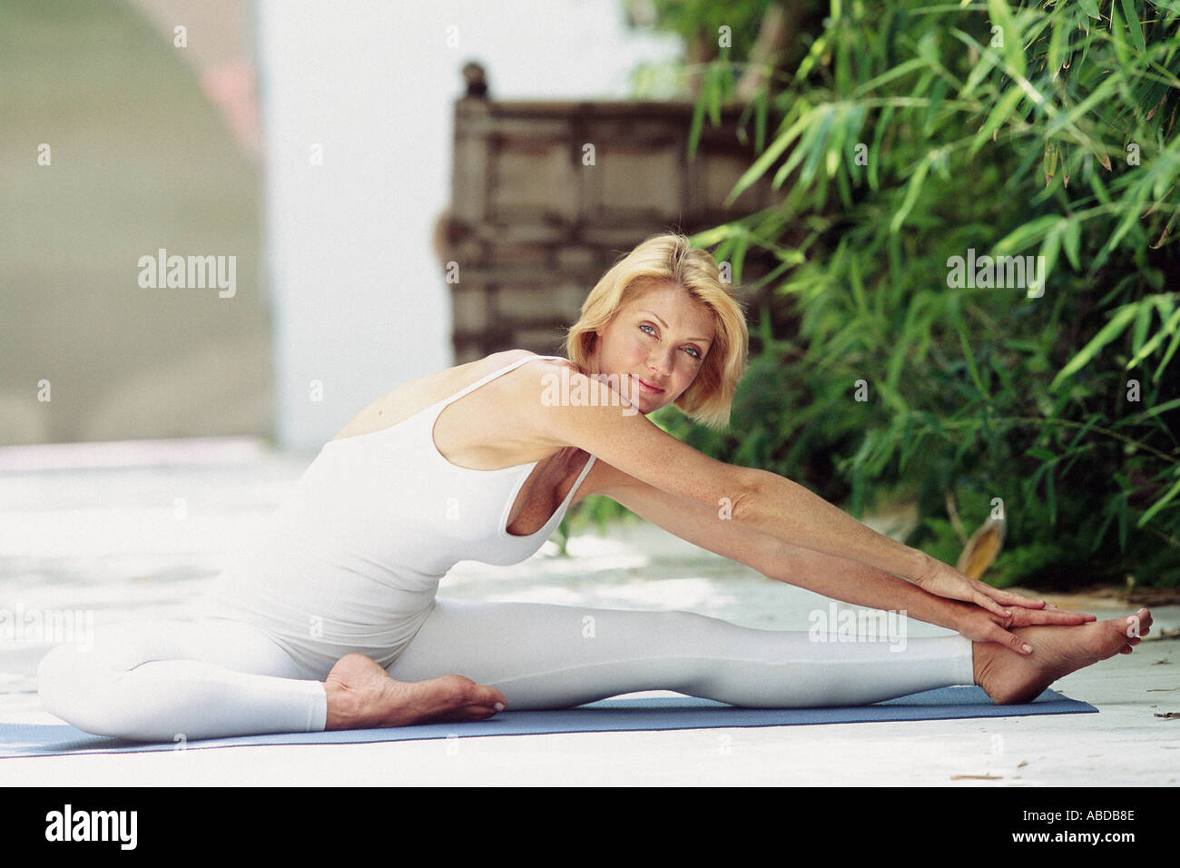 Woman doing yoga outdoors Stock Photo