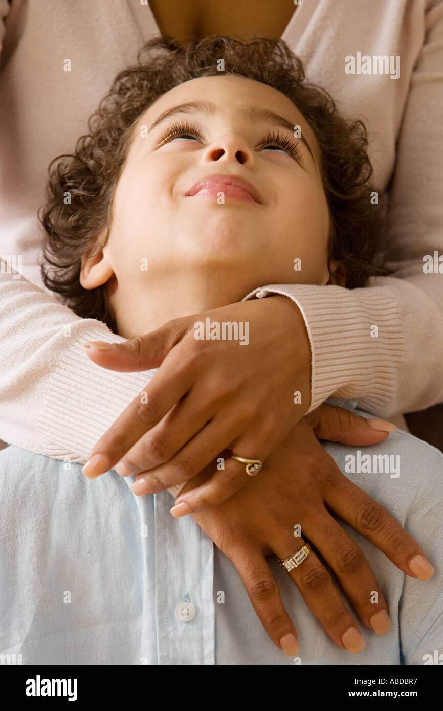 Boy in mother's arms - Stock Image