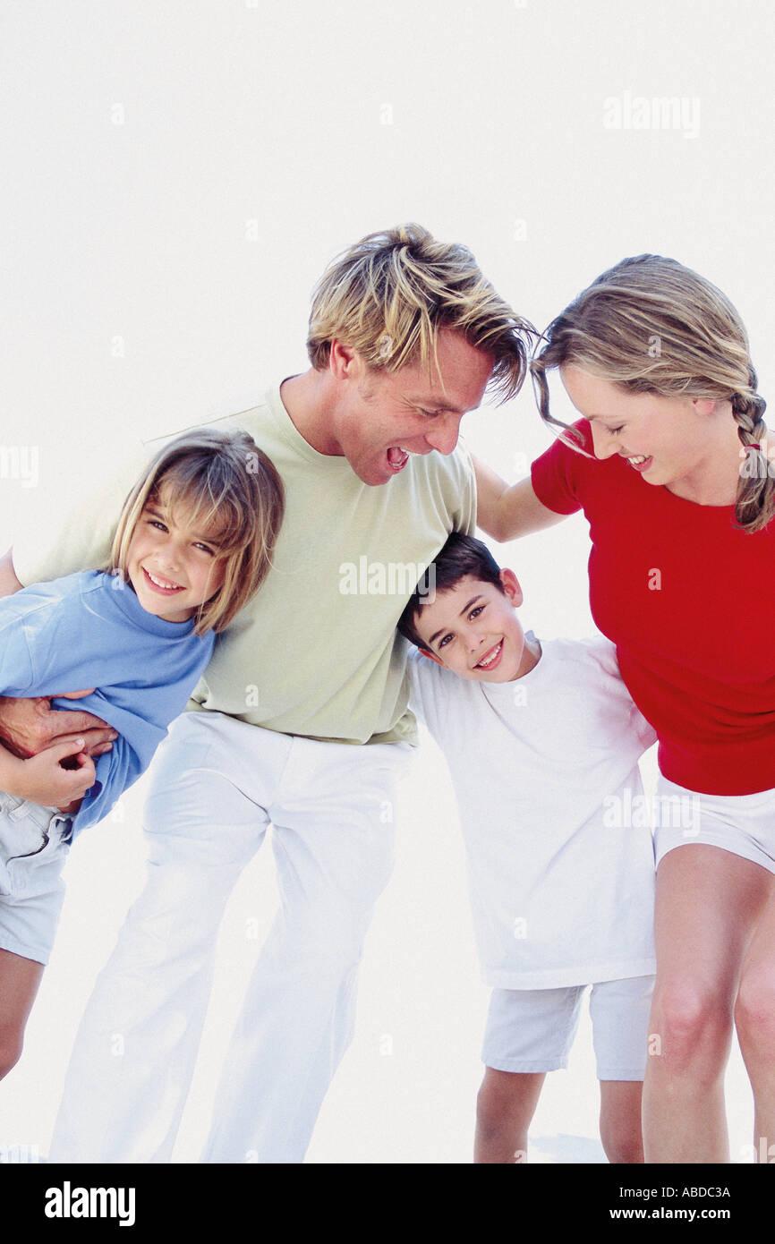 Family hugging Stock Photo