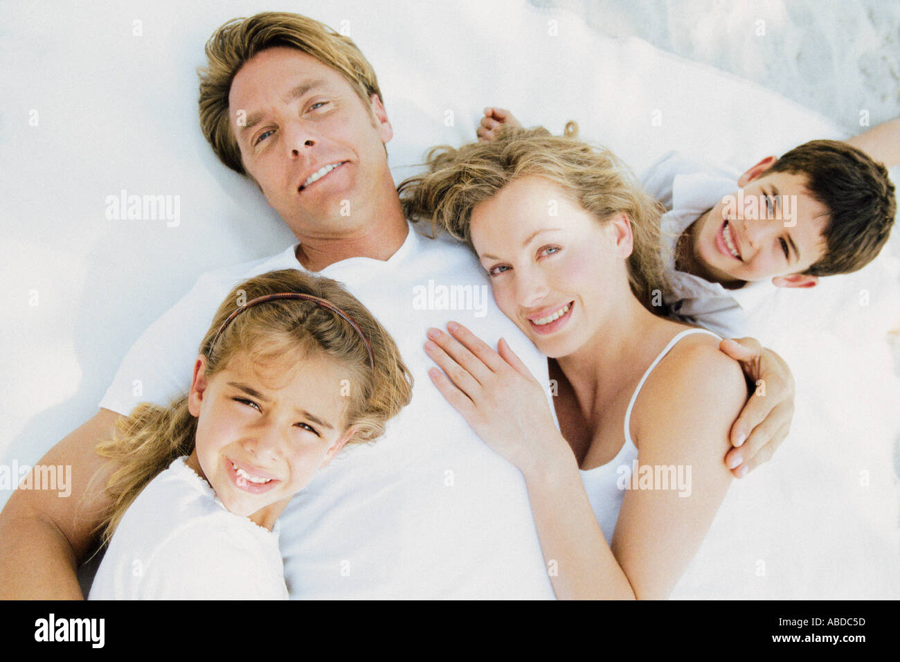 Family lying down - Stock Image