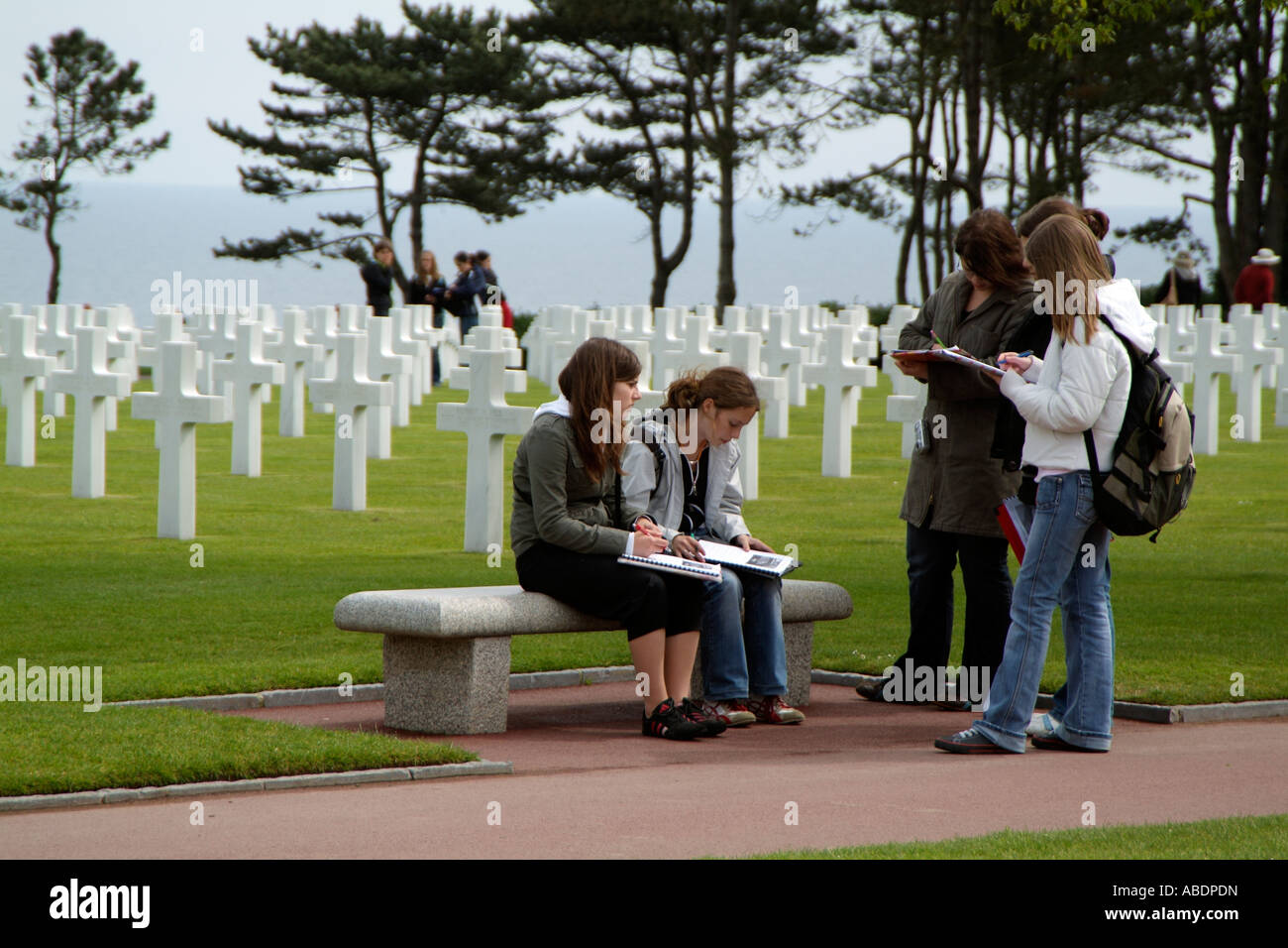 American Cemetery Normandy France School children on an educational visit - Stock Image