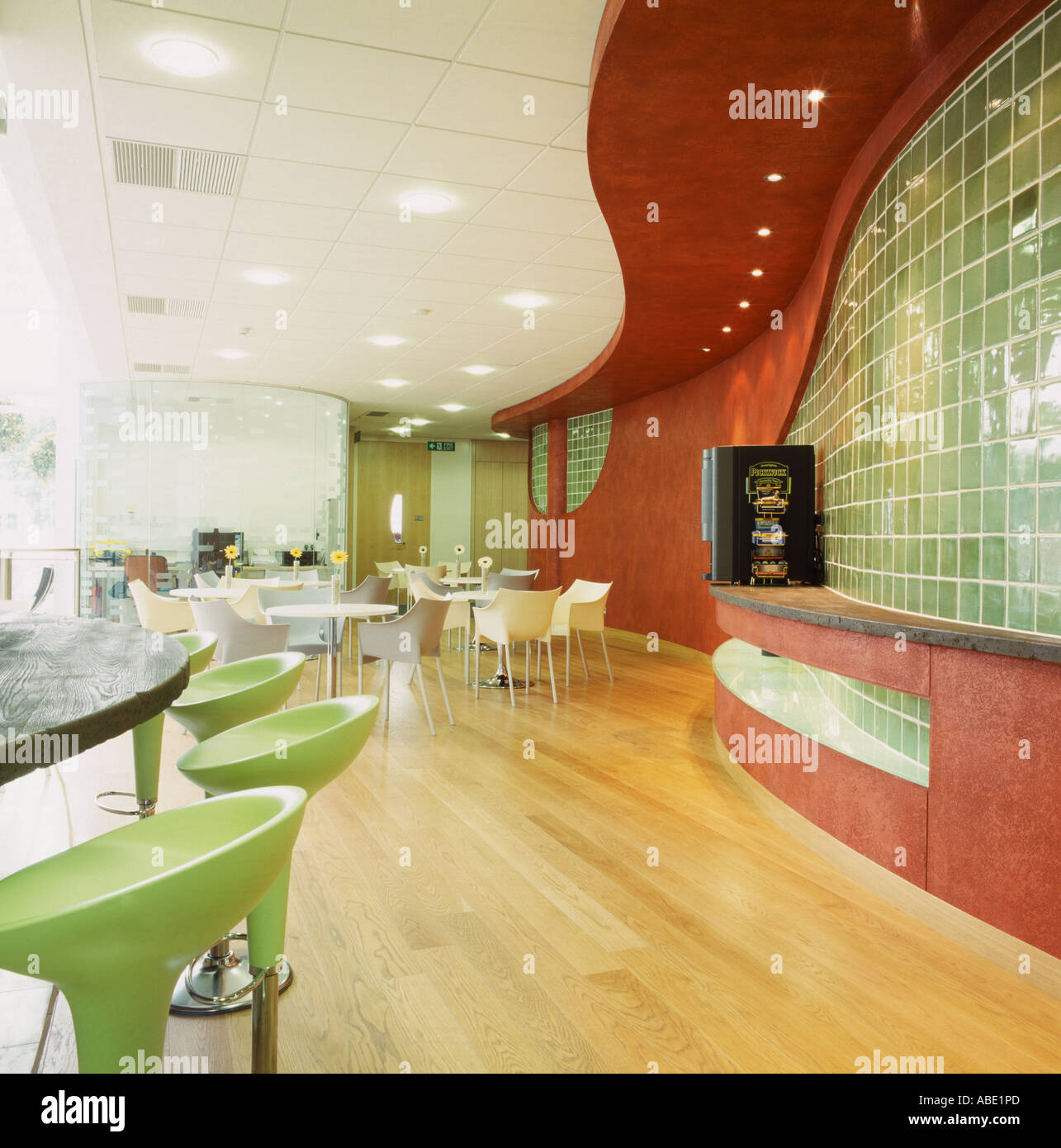 Lime-green Bomba stools at bar in modern white and red restaurant ...