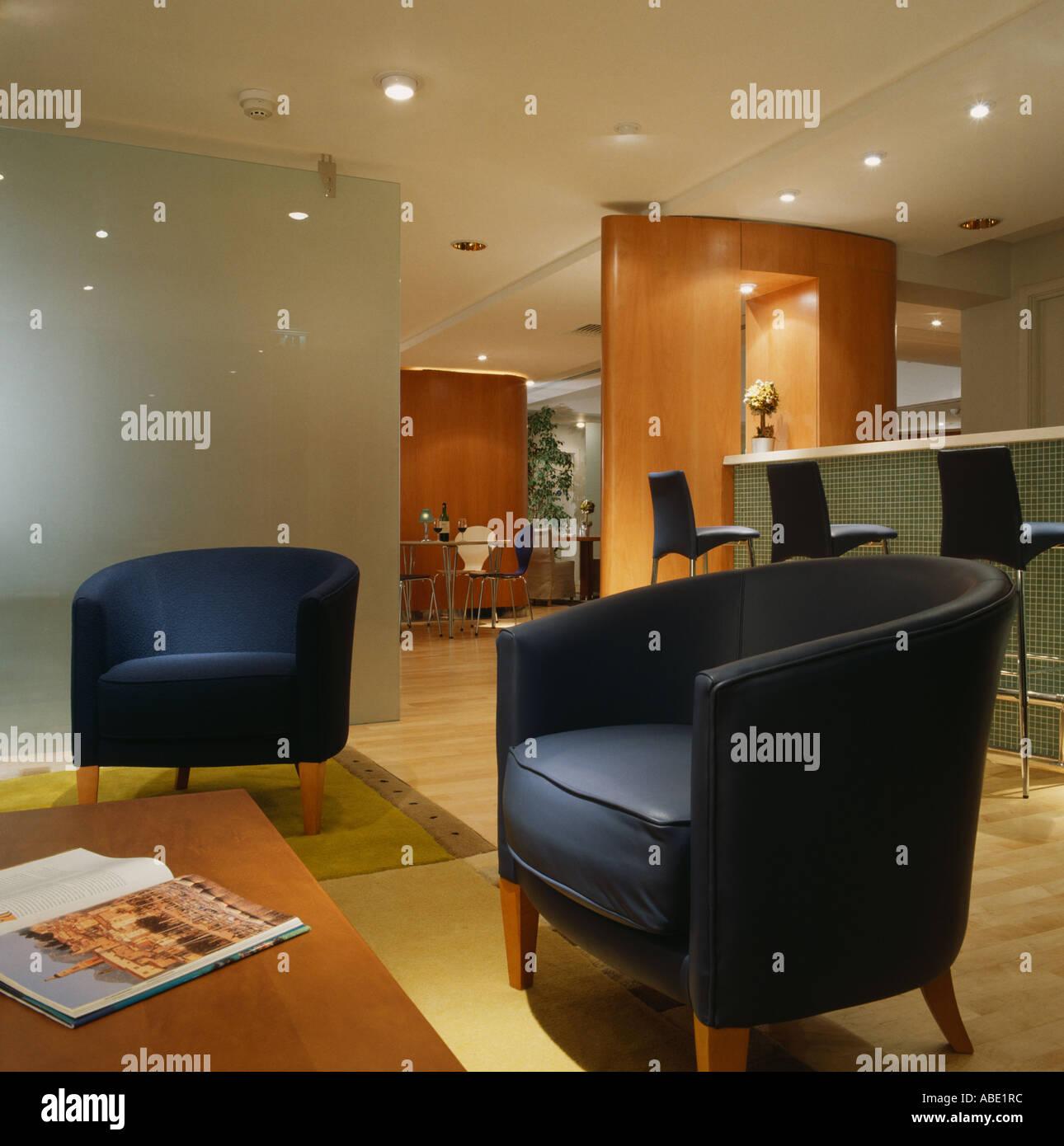 Dark blue tub chairs in modern hotel bar Stock Photo: 7351099 - Alamy