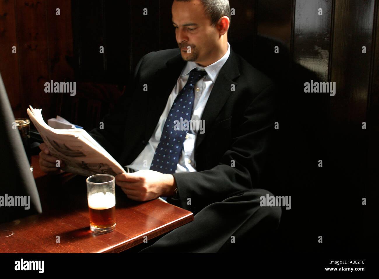 Drinker in the Old Watling Public House London UK - Stock Image