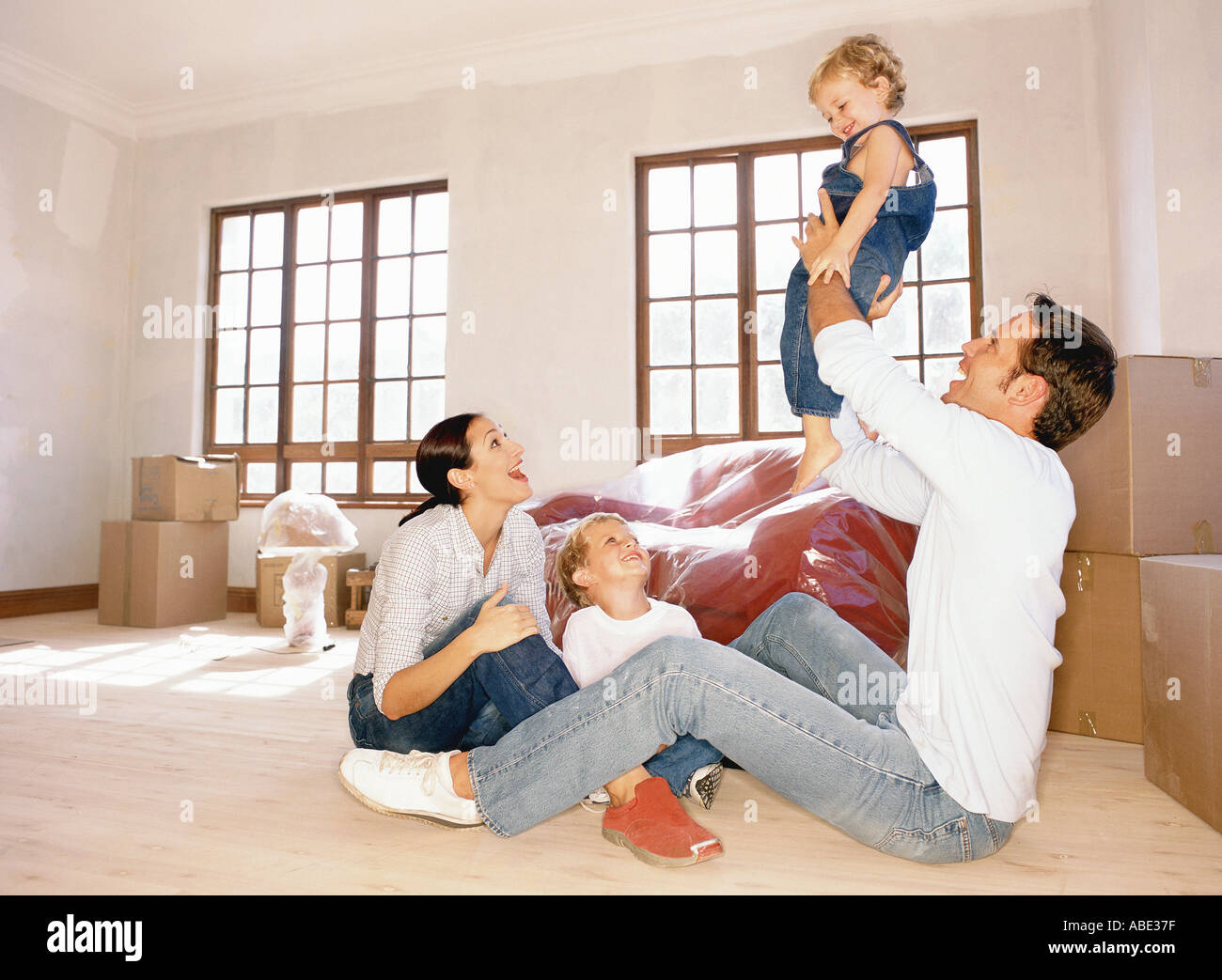 Happy family in new home - Stock Image
