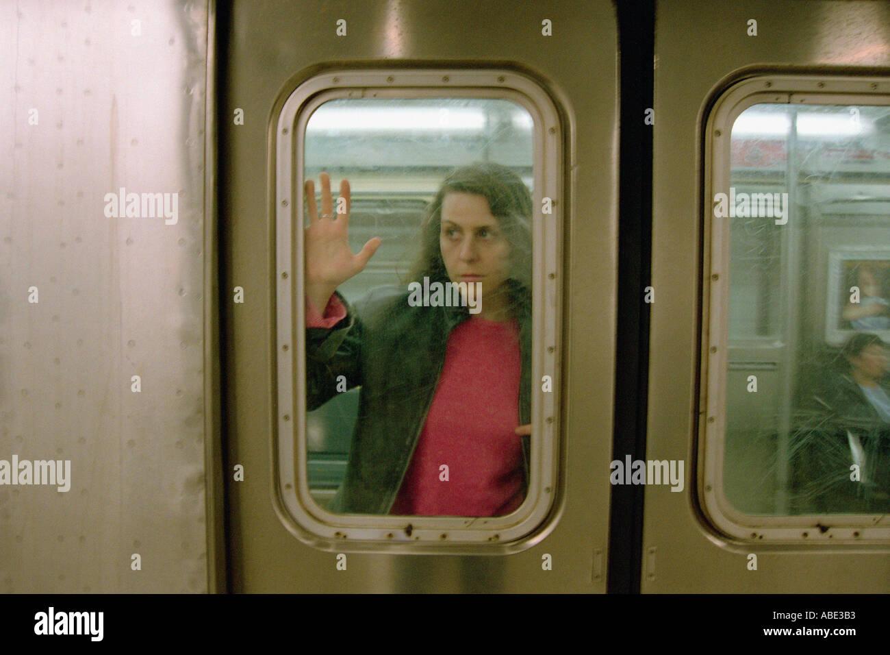 Female commuter on subway train - Stock Image