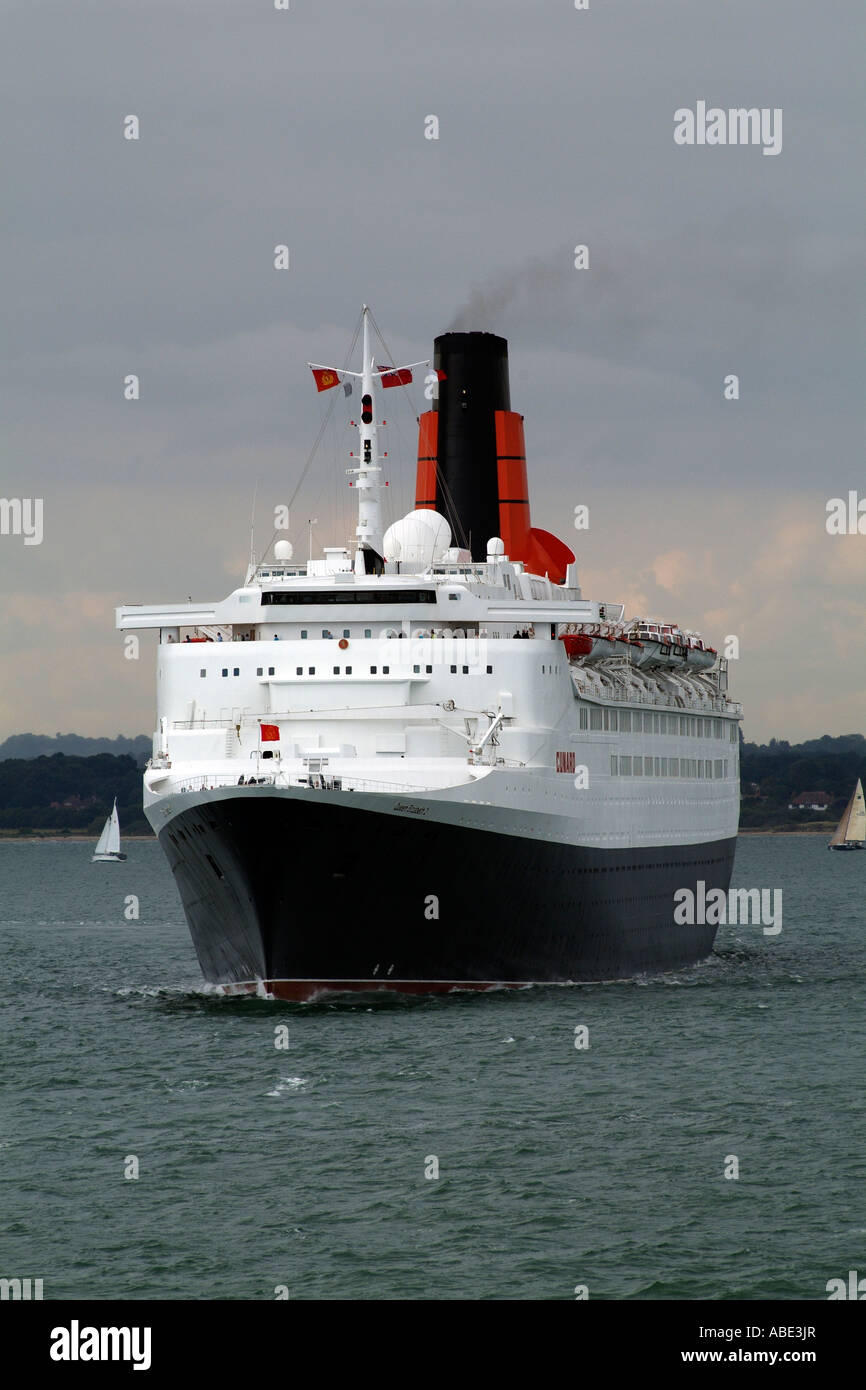 Queen Elizabeth 2 enters The Solent from Southampton Water England UK - Stock Image