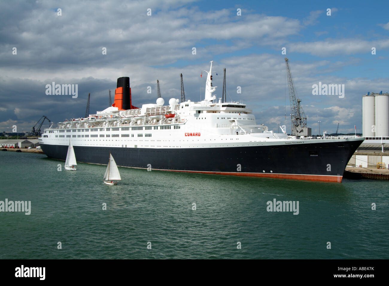 Queen Elizabeth 2 a Cunard cruise liner berthed in the Port of Southampton England UK - Stock Image