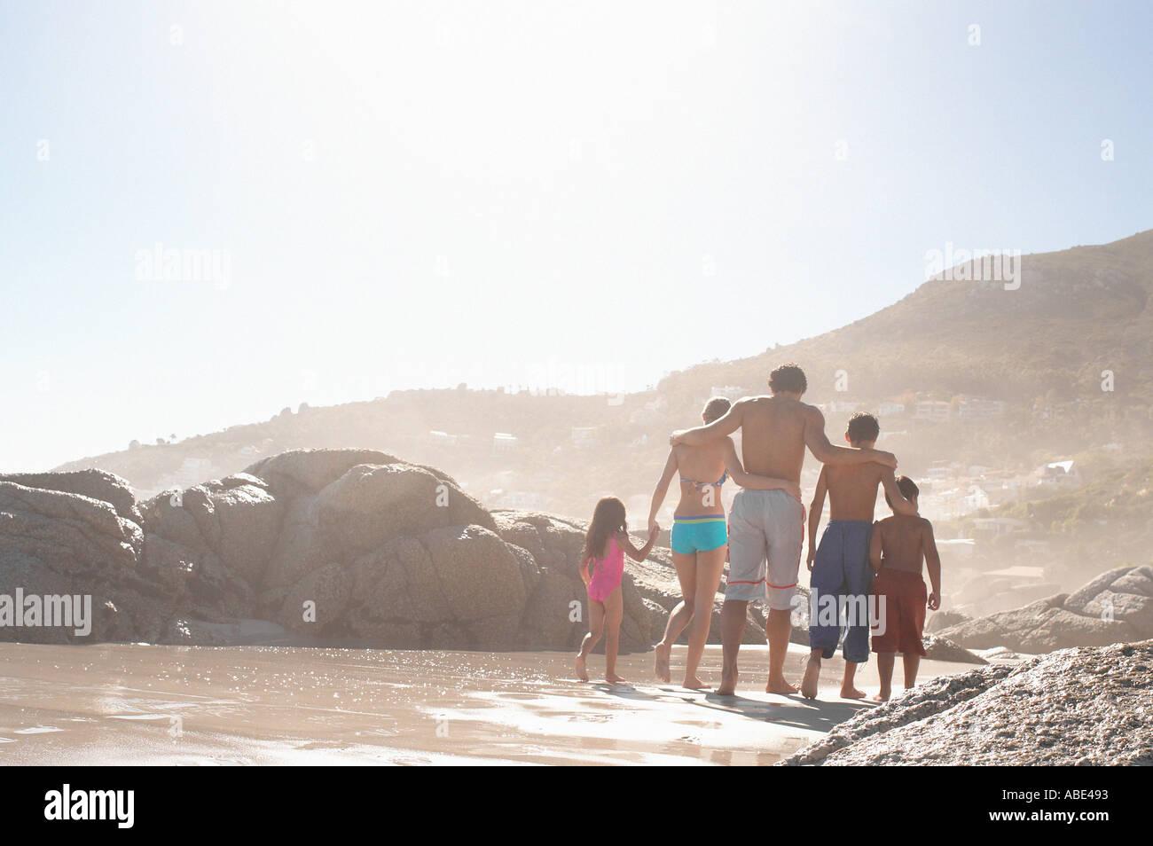 Family walking on a beach Stock Photo