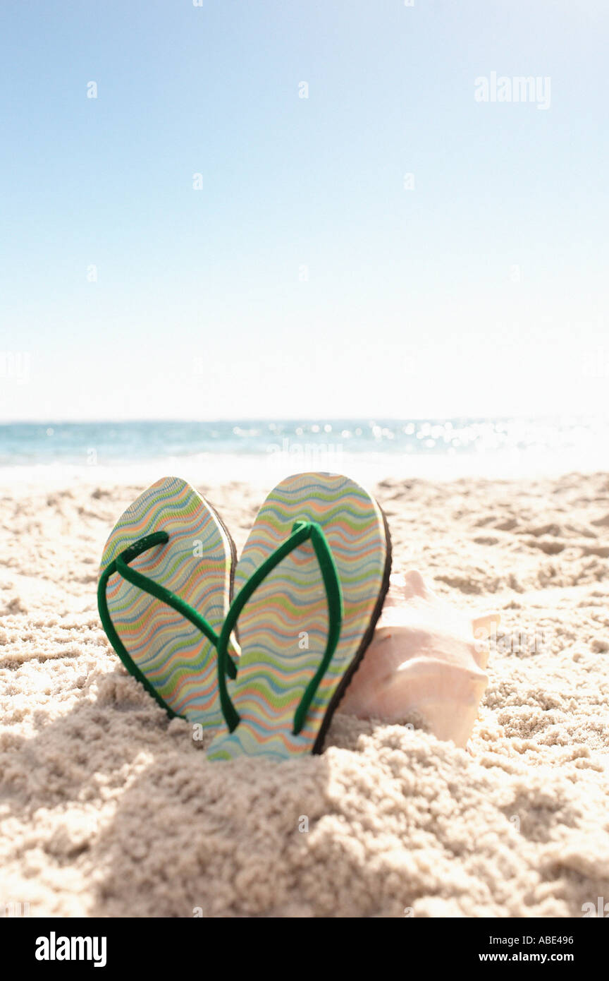 Flip-flops on a beach - Stock Image