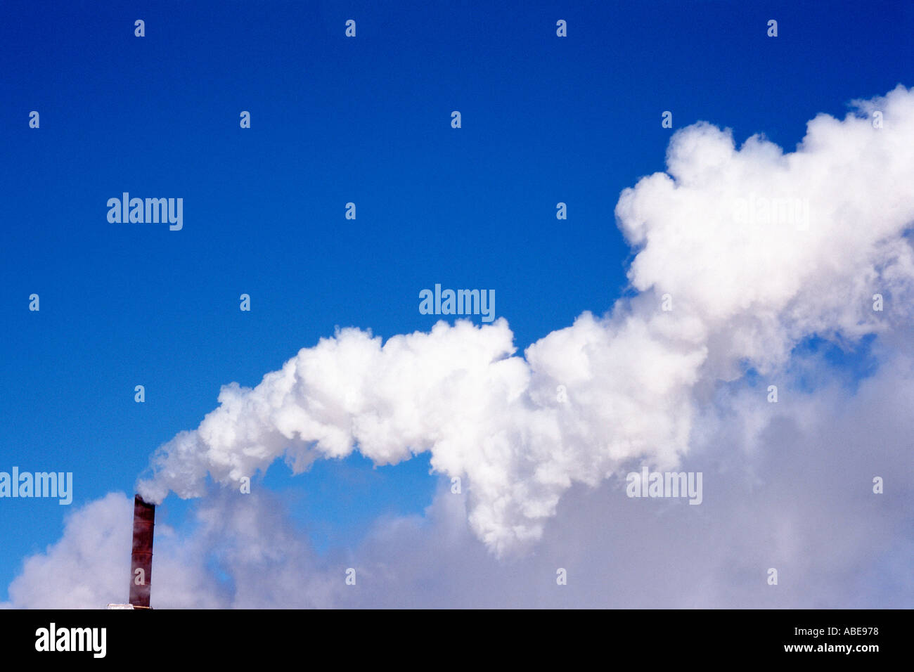 Fumes coming out of a factory chimney - Stock Image