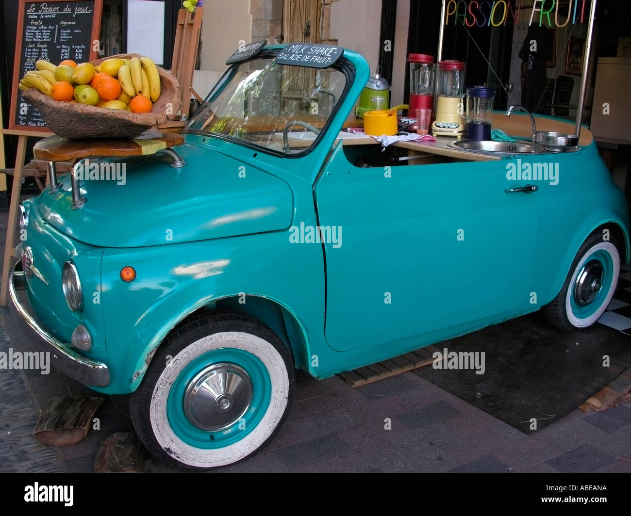 old car fiat 500 in a fruit and juice shop stall stand in. Black Bedroom Furniture Sets. Home Design Ideas